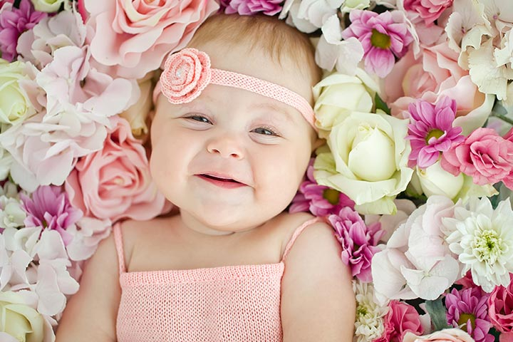 Little baby Smiling in flowers