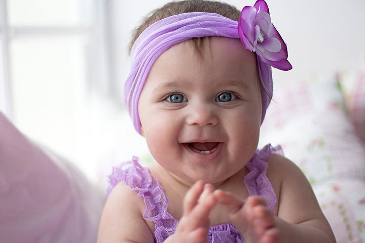 Funny baby girl in cute smile with adorable Head Band