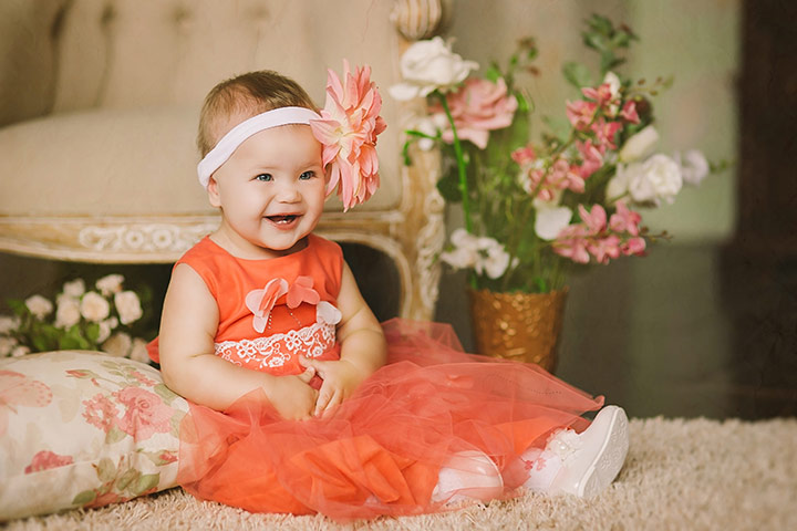The child in an orange dress with smile