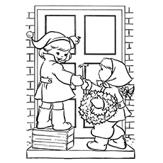 Children Decorating the House During Christmas Season Coloring Pages