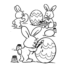 Rabbits Painting Easter Eggs in the Garden Coloring Page