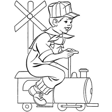 Little Boy Sitting On A Toy Train Coloring Page to Print
