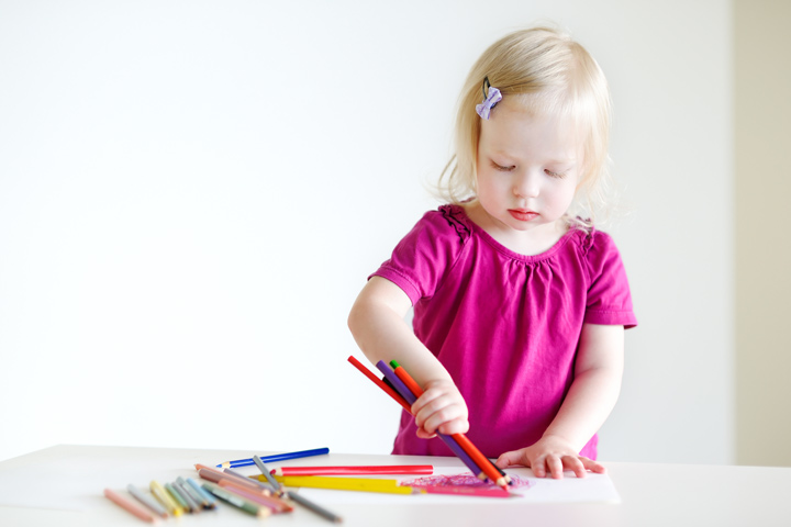 Using Large Crayons To Color