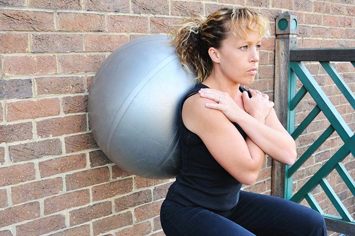 Squats against wall with exercise ball