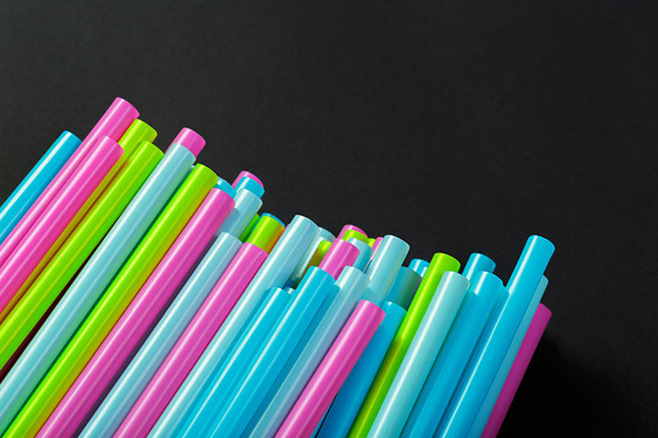 Drinking straws and pom poms