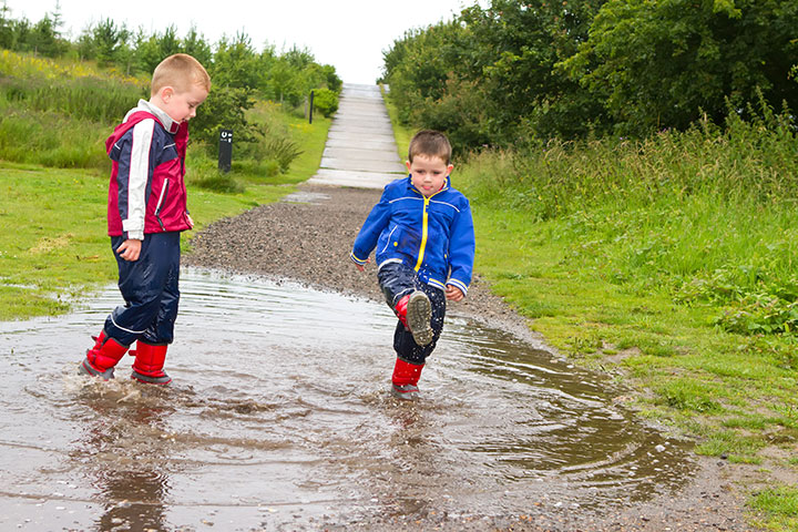 Rainy Day Activities For Kids - Splashing muddy puddles just got more fun