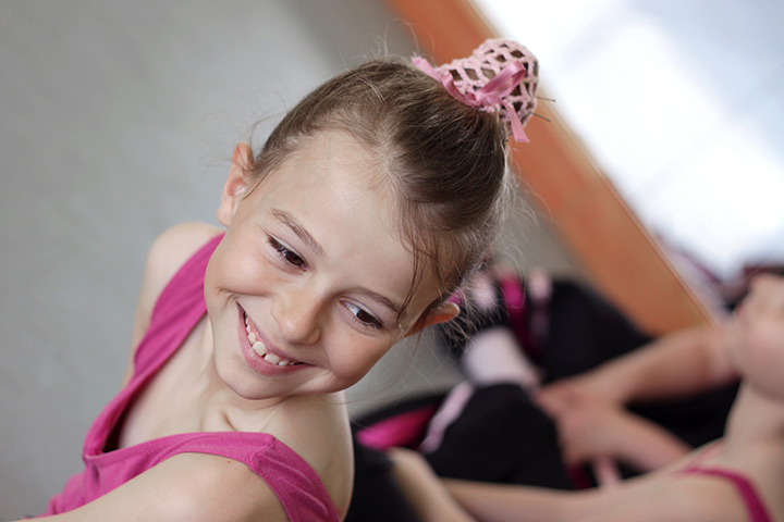 Hairstyles For Kids With Long Hair - Topknot Ballerina Bun
