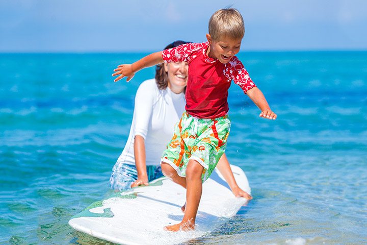 Give him his first lessons on surfing.