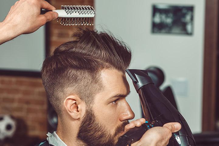 High fade with slick back haircut