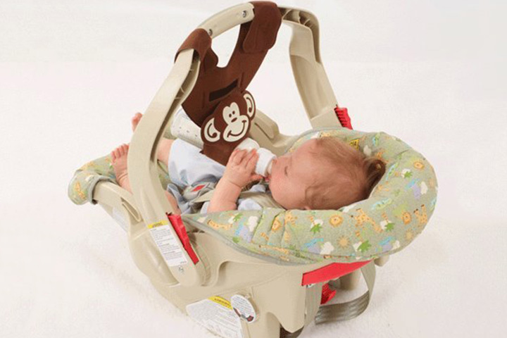 A bottle sling attachable to baby car seat is brilliant! No hassles while you take him out.