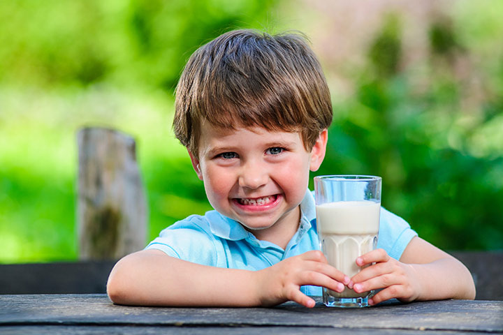kid with a glass of milk
