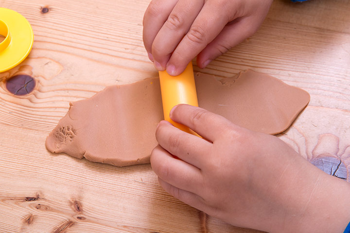 Writing Activities For Preschoolers - Stamp The Name On The Play Dough