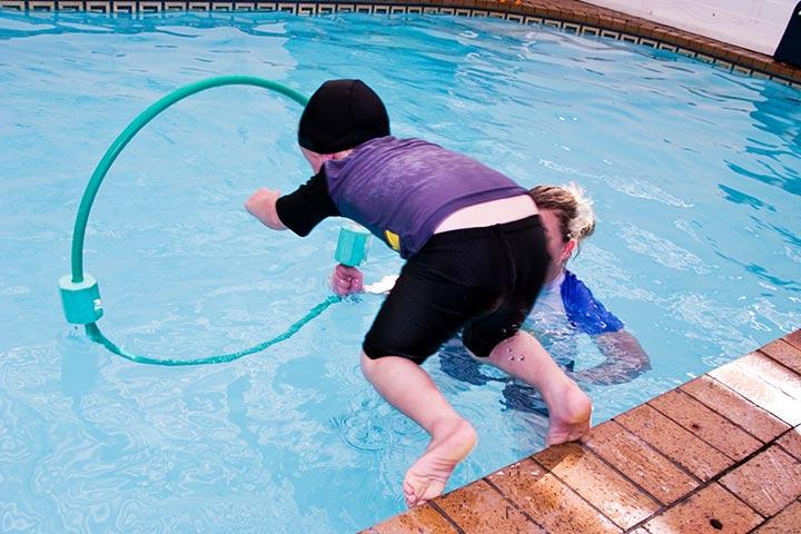Swim through the hula-hoop