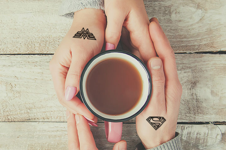 Superman and Wonder Woman tattoos