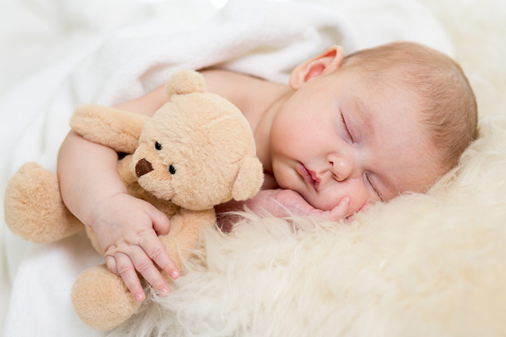 Placing Toys In Baby's Bed