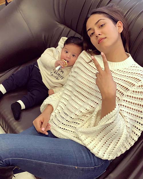 There's no reason moms can't twin with their baby boys. Mira is seen wearing a white top with Zain sporting a sweatshirt of the same color.