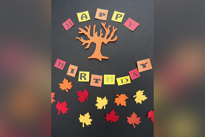 Greeting card with real fall leaves