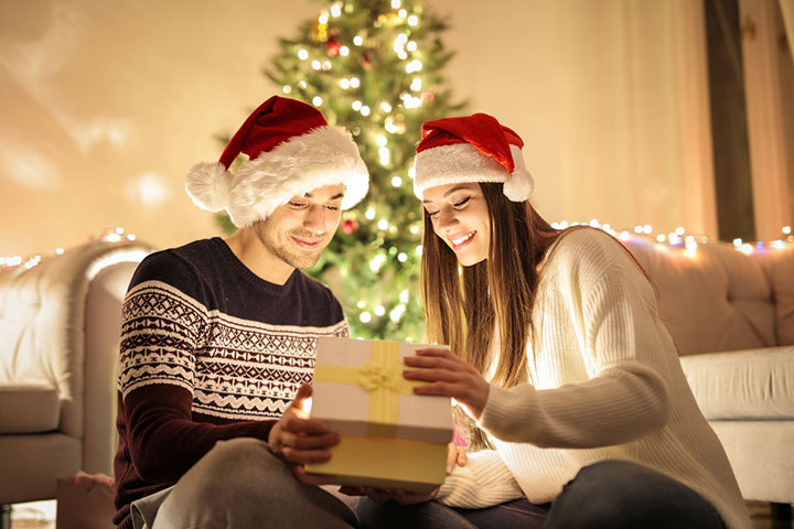 Open gift wearing Christmas caps