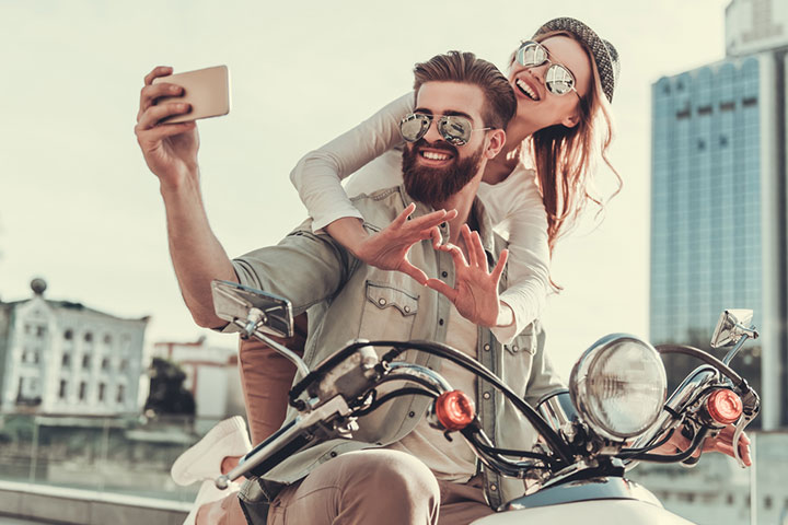 Posing on a motorbike with sunglasses