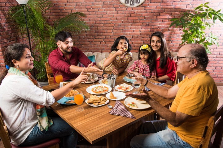 indian-multigenerational-family-eating-food-dining-1803745366