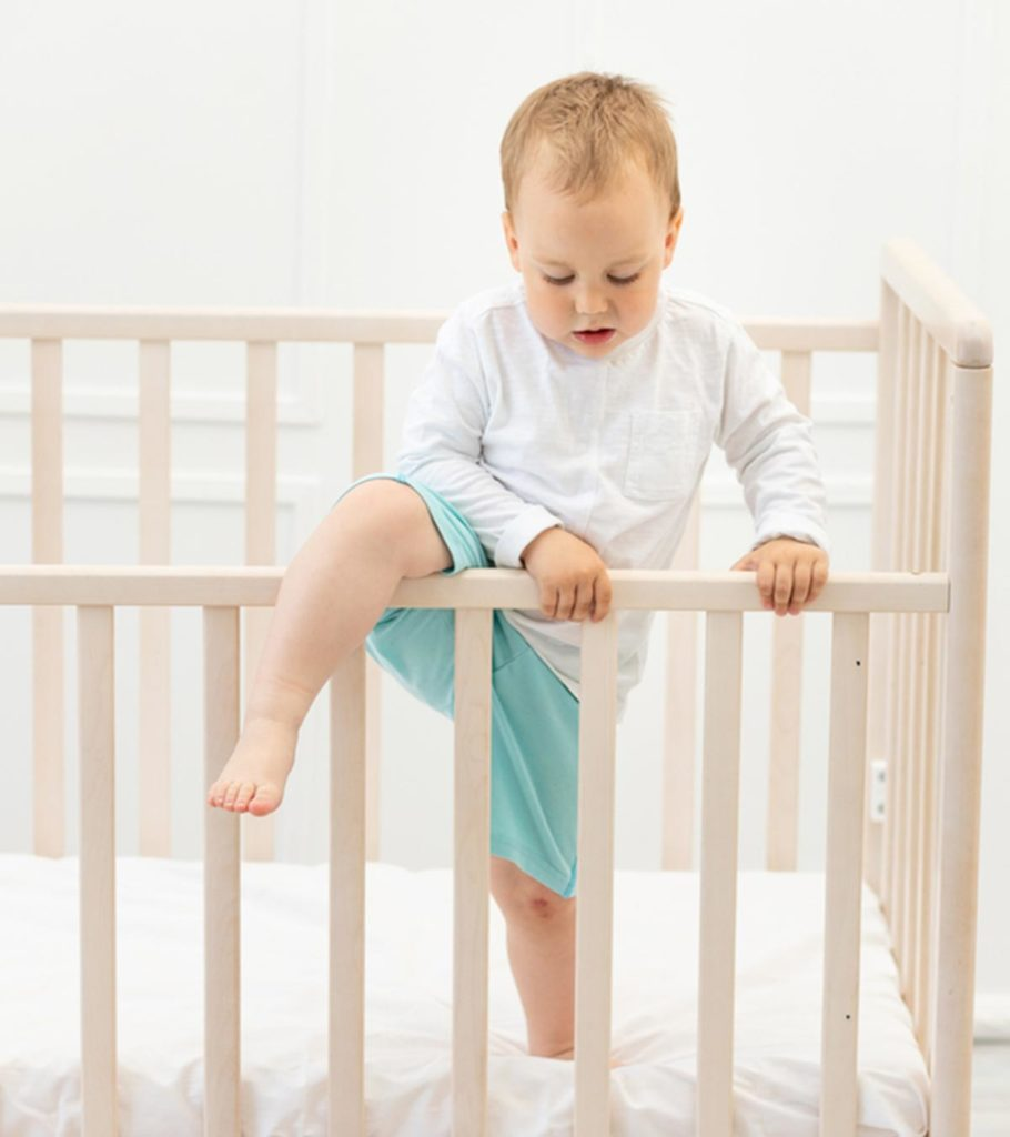 5 Tips To Keep A Toddler From Climbing Out Of Crib 910x1024