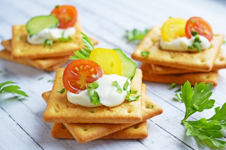 delicious-crackers-cheese-sauce-vegetables-on-1473919223