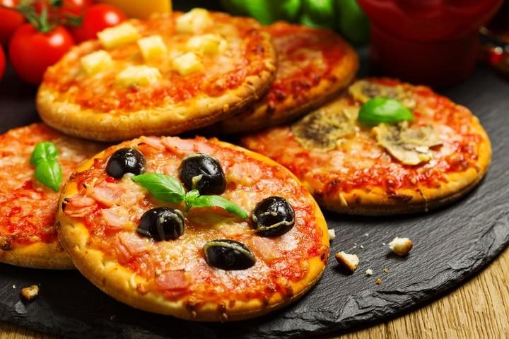 mix-mini-pizzas-on-stone-try-431605438