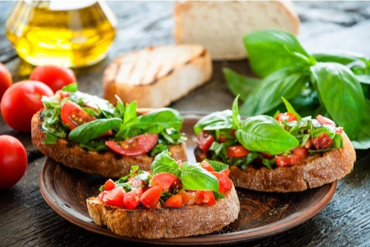 italian-tomato-bruschetta-chopped-vegetables-herbs-193674488
