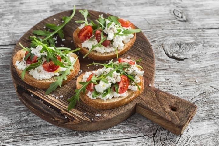 sandwiches-cheese-tomatoes-arugula-on-rustic-414527557