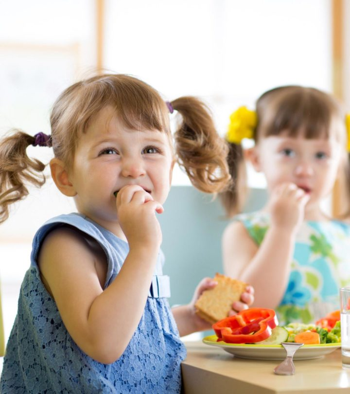 cute-little-children-eating-food-daycare-727282390