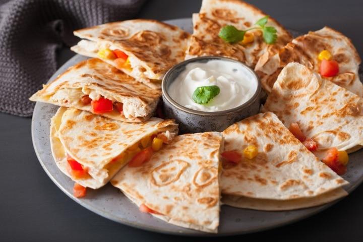 mexican-quesadilla-with-chicken-tomato-corn-cheese-picture-id936478704?s